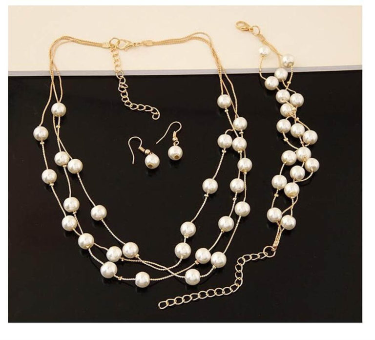 pearl gold jewelry set includes necklace earings and bracelet
