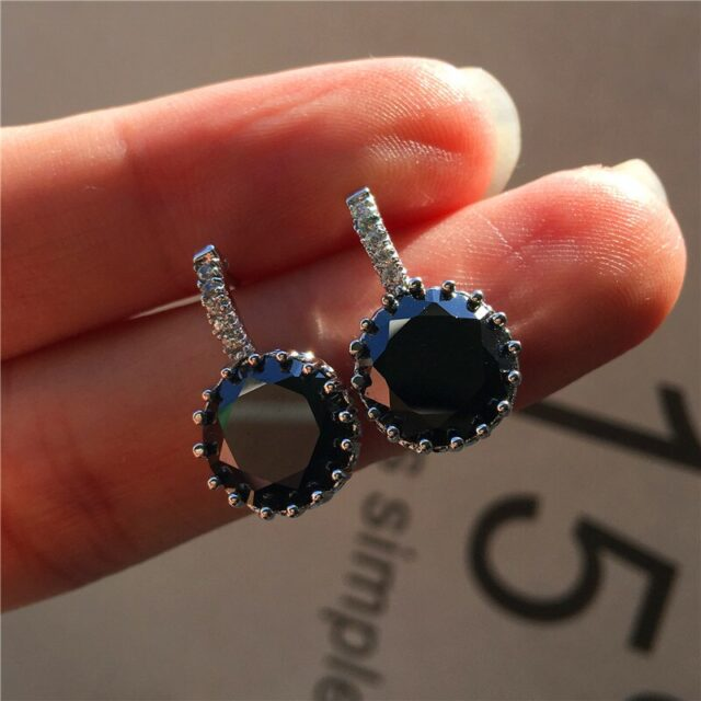 silver earring with black stone